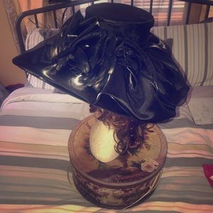 Black satin vacation derby hat